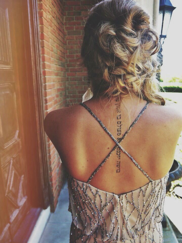 vertical back tattoos