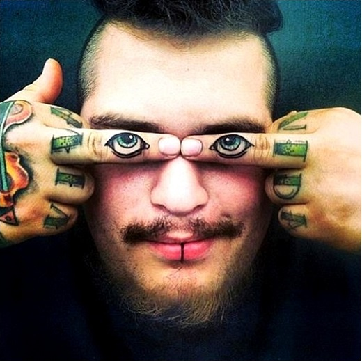 eye finger tattoos
