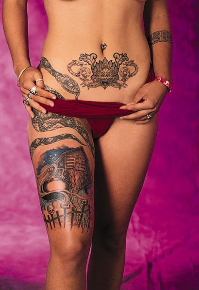 wrap around thigh tattoos