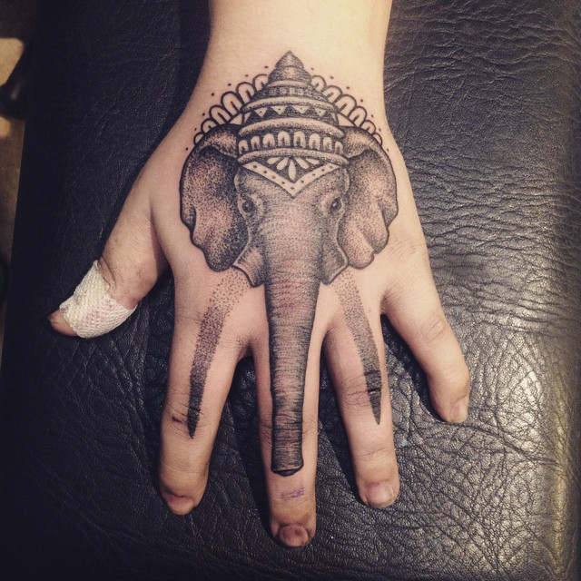 elephant hand tattoos